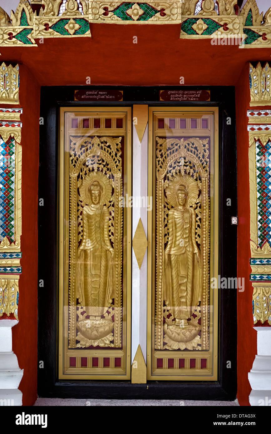Ornate Thai Buddhist temple entrance doors with glass encased golden figures . Thailand S. E. Asia & Ornate Thai Buddhist temple entrance doors with glass encased ... Pezcame.Com