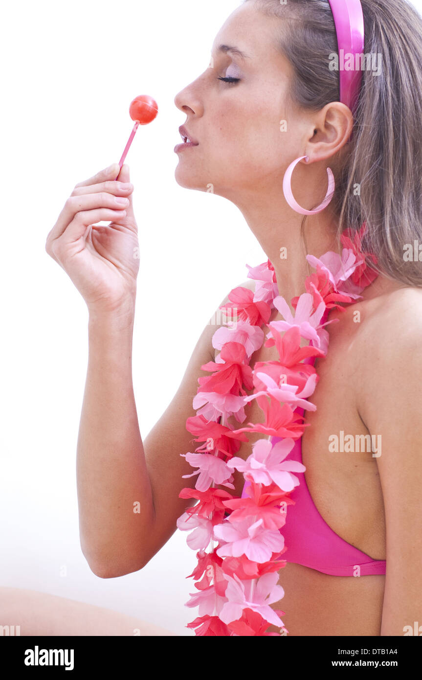 lolly model Stock Photo - Young woman with bikini and flower necklace enjoying a lolly ( model-released