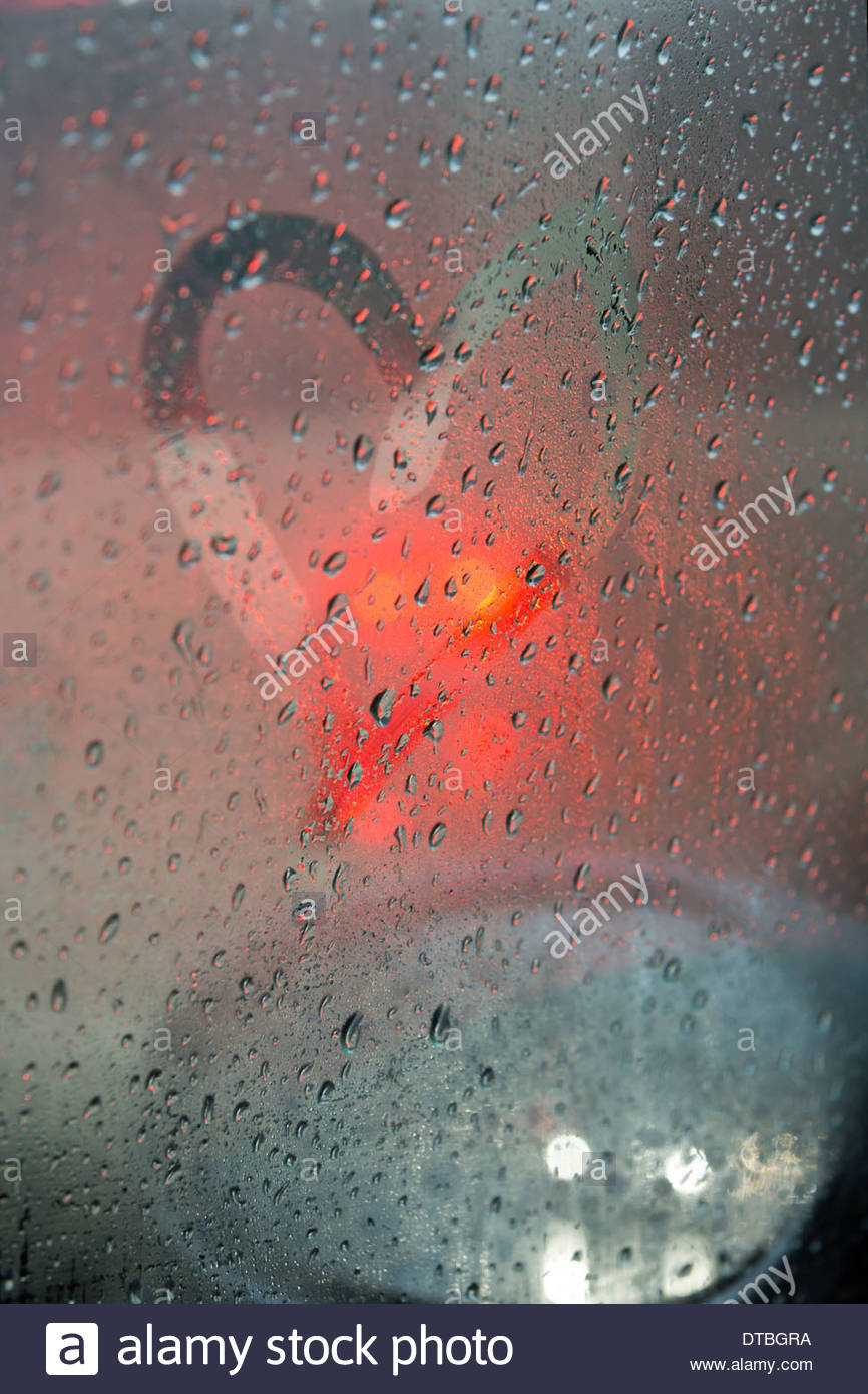 Studded car window with a heart in the rain Stock Photo ...