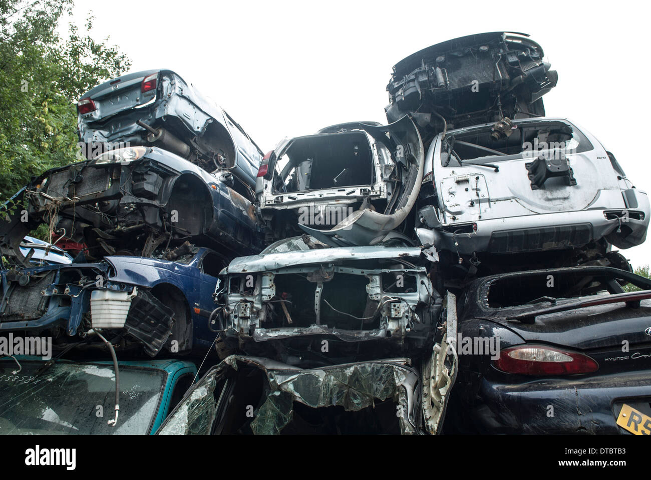 Crushed cars in scrap yard UK Stock Photo, Royalty Free Image ...