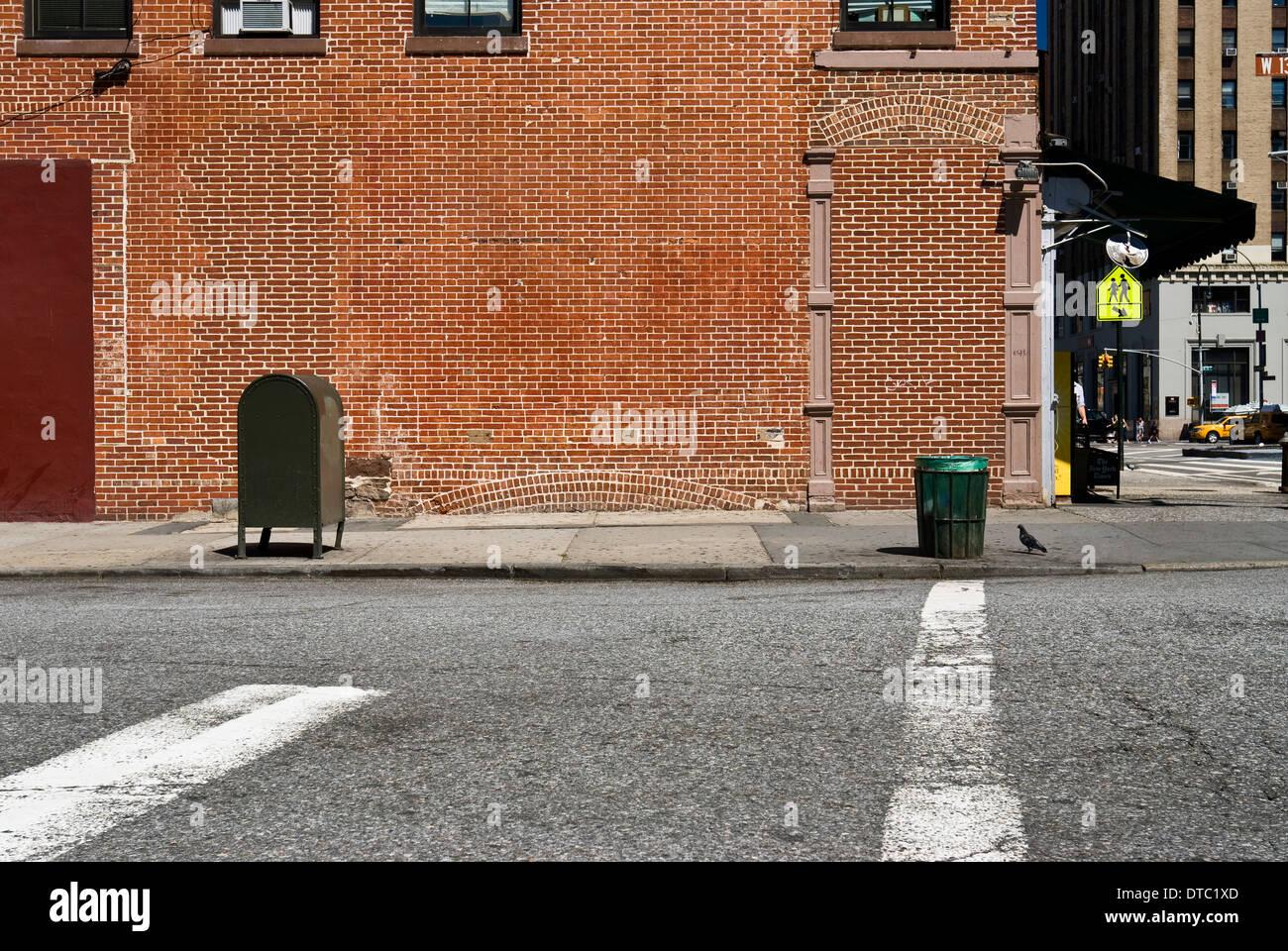 Empty urban street scene with brick wall in New York City ...