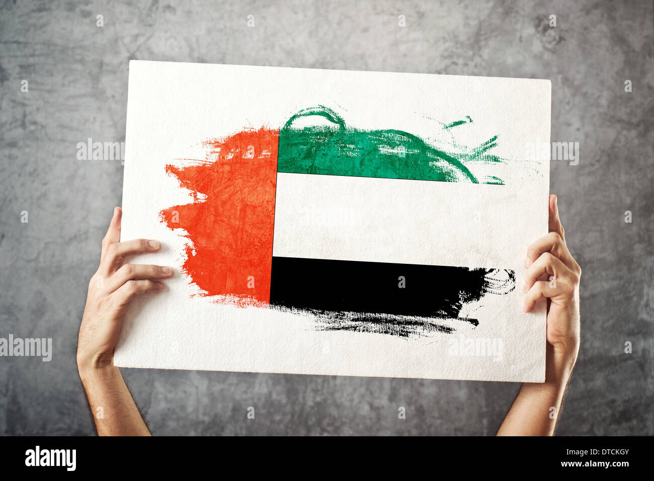 Men holding the word party concept 3d illustration stock photo - Man Holding Banner With Uae Flag Supporting National Team