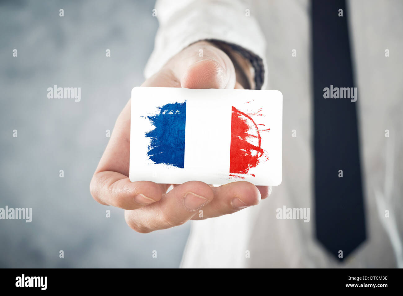 French businessman holding business card with france flag stock french businessman holding business card with france flag international cooperation investments business opportunities colourmoves Image collections