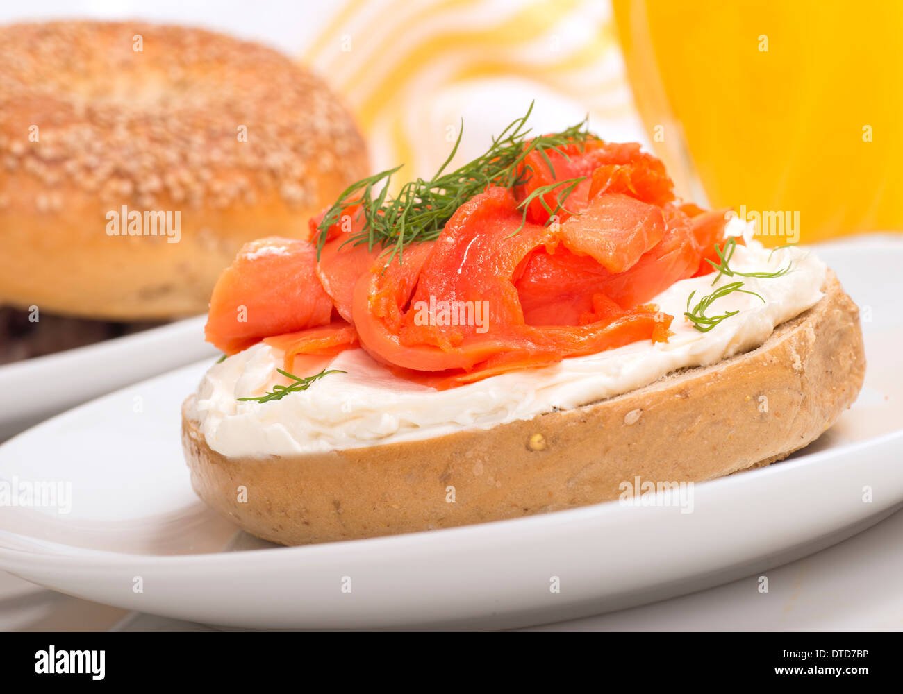 Delicious freshly made bagel with cream cheese, smoked ...