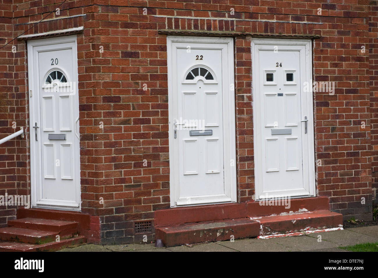White number 20 22 \u0026 24 plastic front doors of houses in Scarborough North Yorkshire England UK & White number 20 22 \u0026 24 plastic front doors of houses in ...