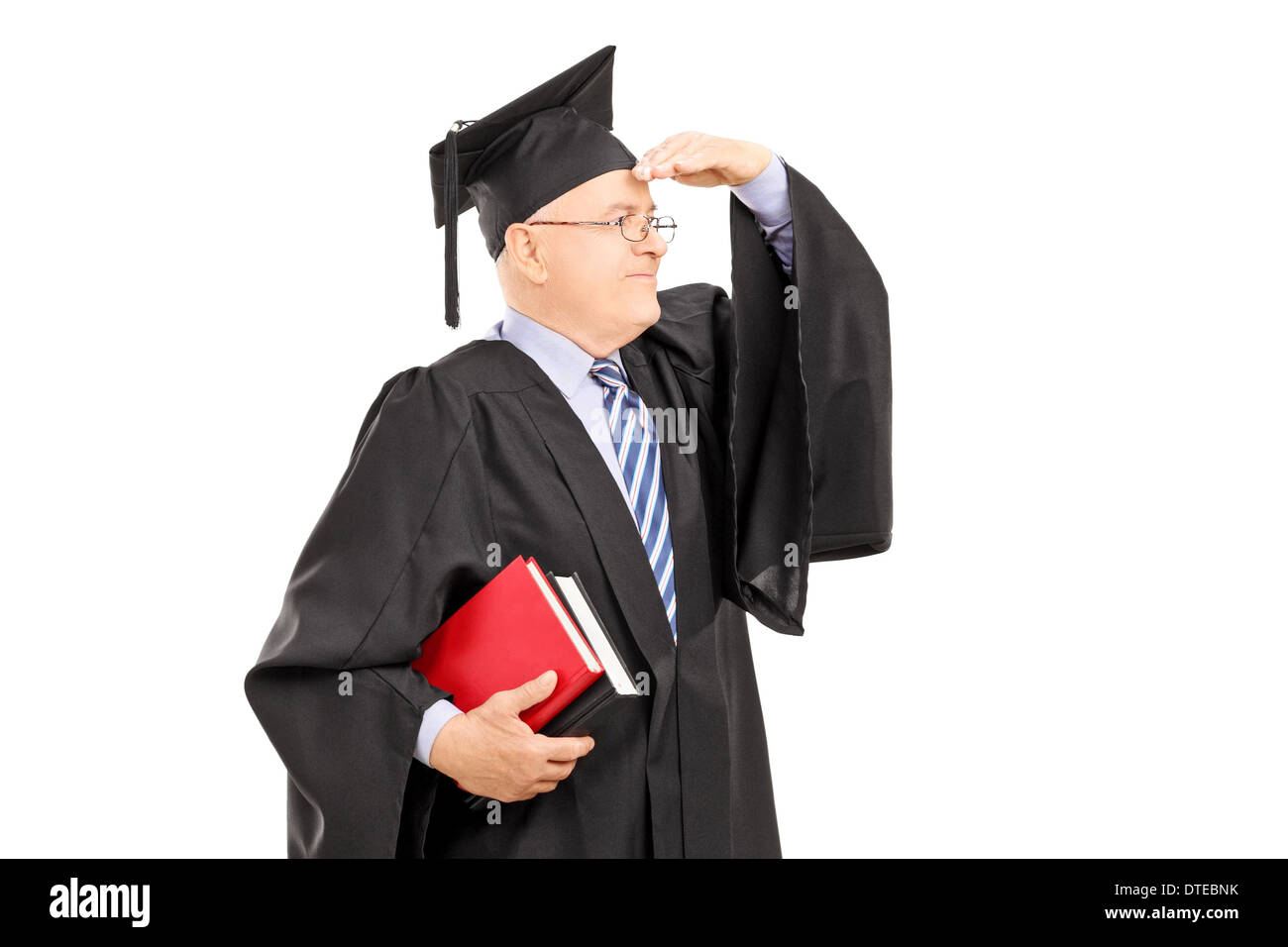 Male College Professor In Graduation Gown Looking With Hand Over ...