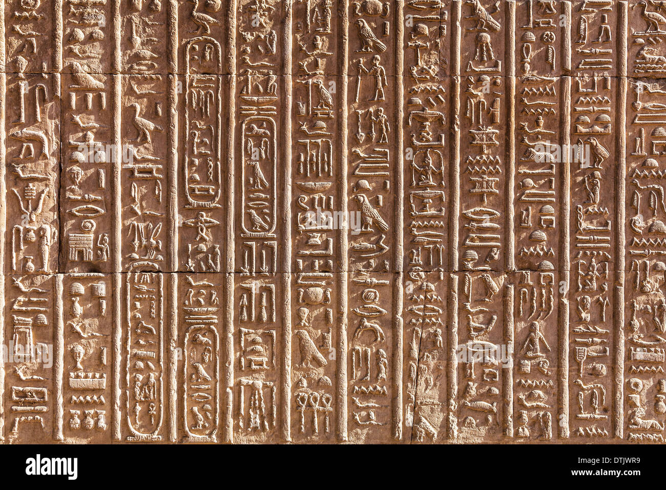 Bas relief hieroglyphic carvings on a wall of the ancient