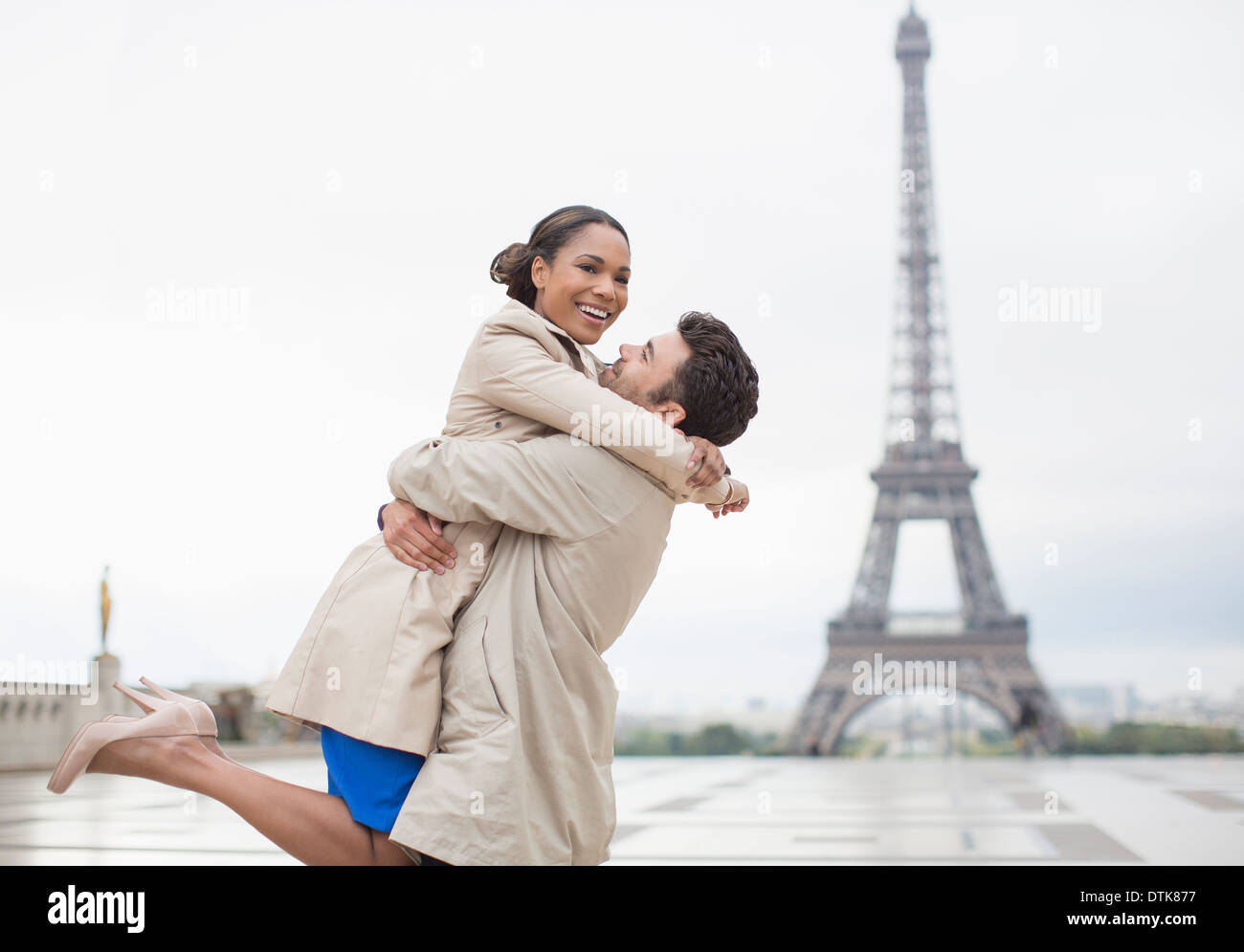 Couple hugging by Eiffel Tower  Paris  France. Couple Hugging By Eiffel Tower  Paris  France Stock Photo  Royalty