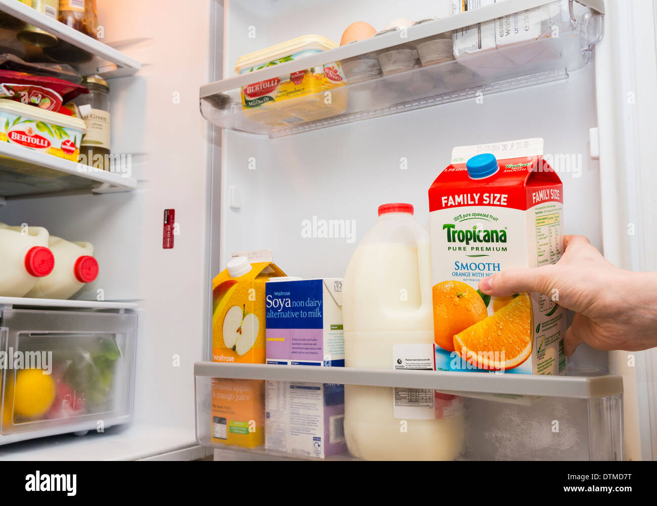 A hand pulling out a carton of Tropicana orange juice from a fridge door - Stock & A hand pulling out a carton of soya milk from a fridge door Stock ... Pezcame.Com