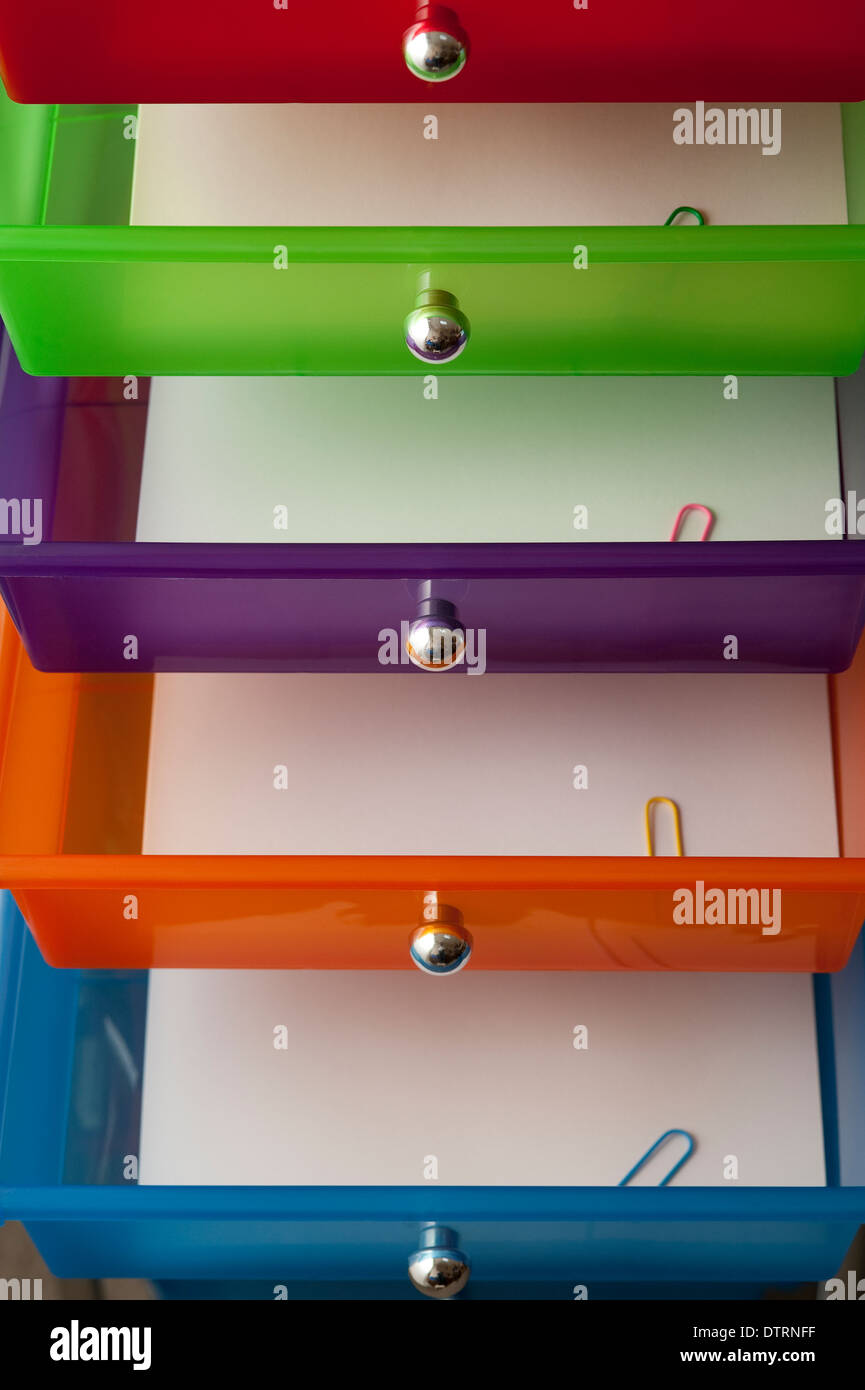 Mulicolored Office Drawers Close Up Views Of Colorful Drawers With Paper  And Colorful Paper Clips