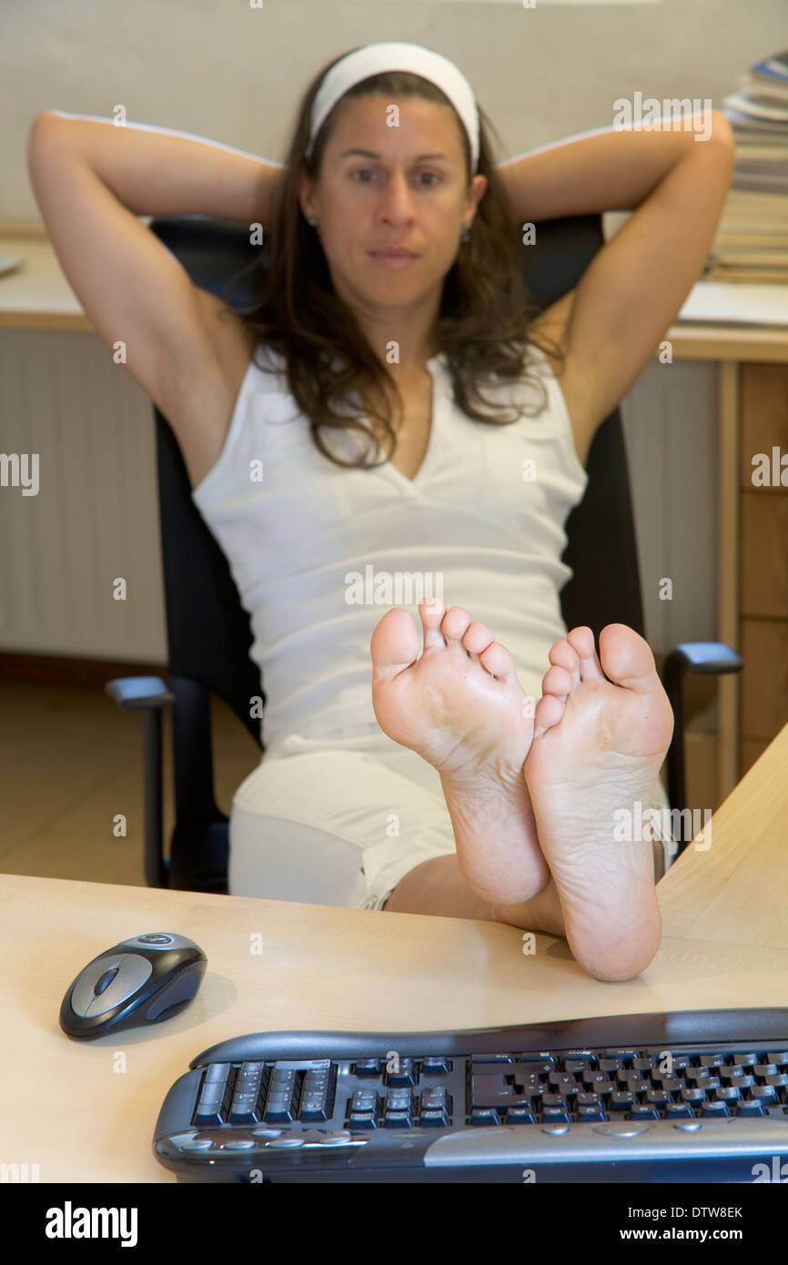 Feet Up On A Desk At The Office Stock Photo Royalty Free