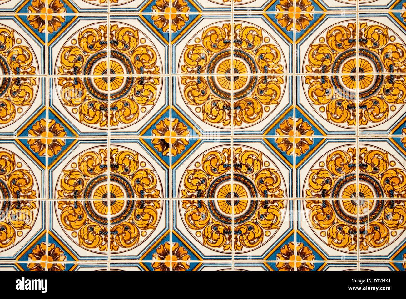 Blue ceramic tiles on wall stock photos blue ceramic tiles on gold and blue patterned ceramic tiles on an external wall in portugal stock image dailygadgetfo Image collections