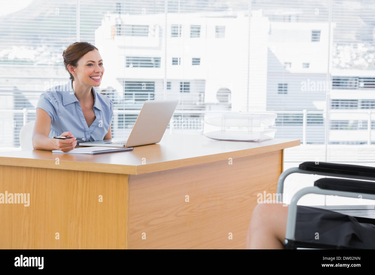 businessw smiling at disabled interviewee stock photo royalty businessw smiling at disabled interviewee