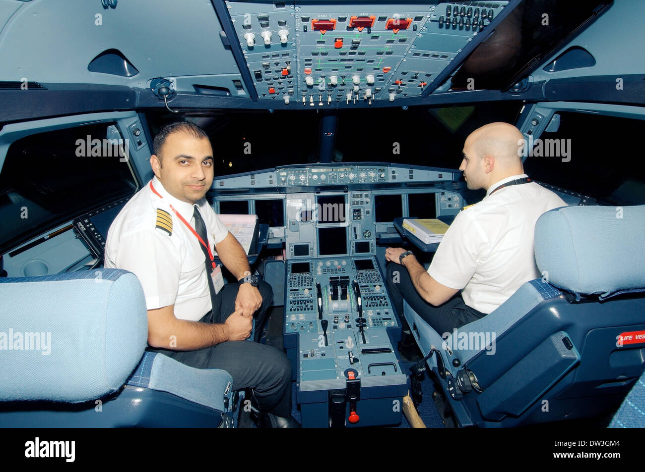 Pilots aircraft airbus a 320 in the cockpit airport sharjah sharjah emirate uae