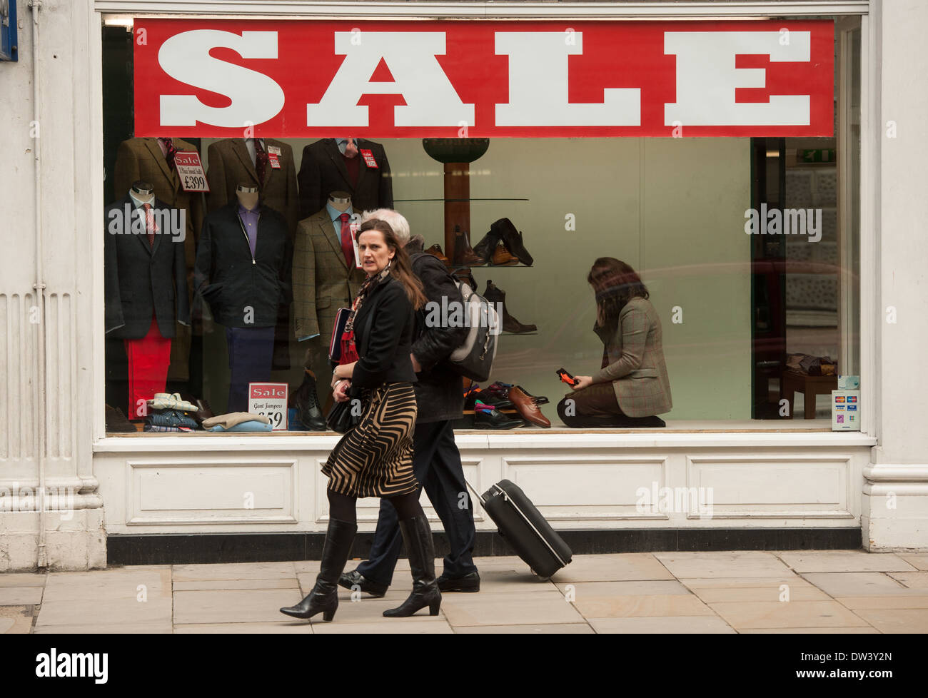 s assistant shoes stock photos s assistant shoes stock a shop assistant stocks up a shop window in the city of london stock