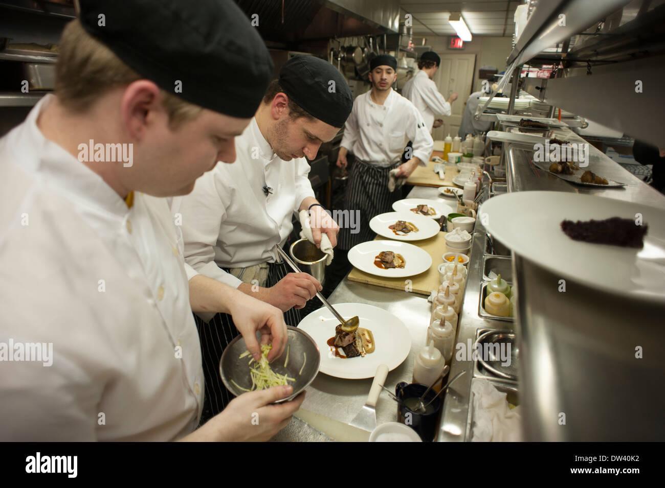 Busy Restaurant Kitchen chefs working in busy kitchen at sanford's restaurant in milwaukee