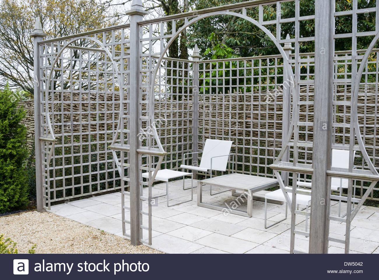 Trellis featuring Moorish arches defines a modern seating area ...