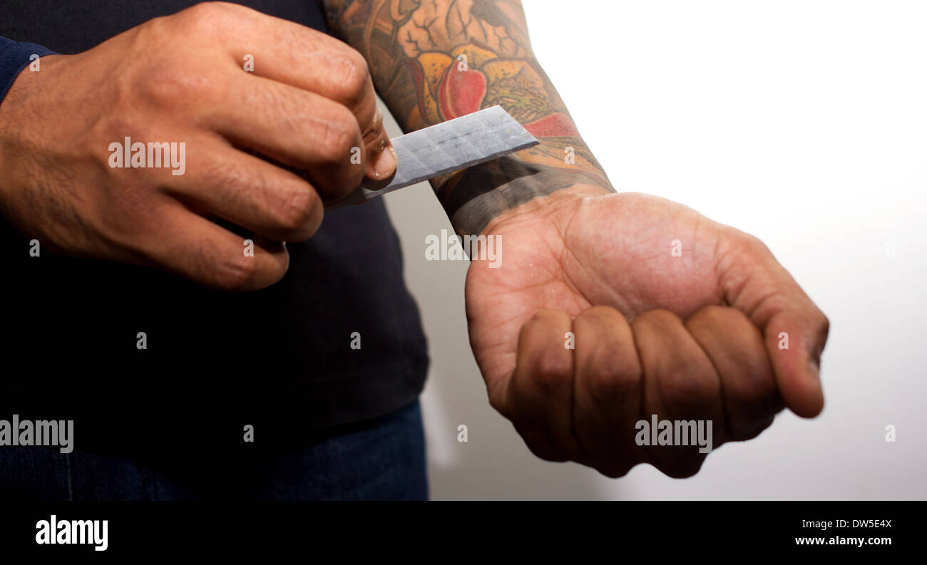 Male with tattoos cutting wrist Stock Photo, Royalty Free ...
