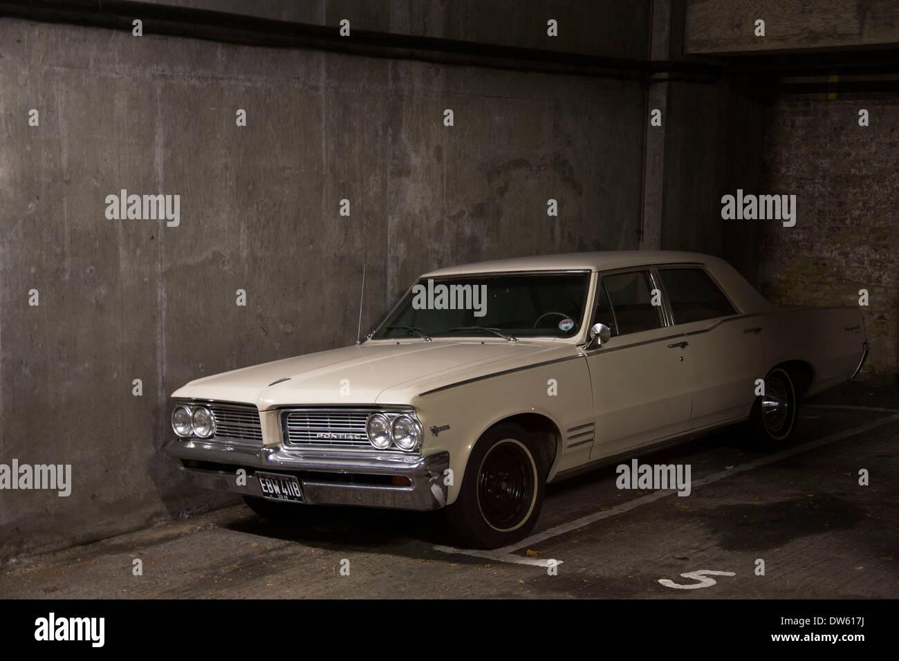Vintage Pontiac V8 326 car in an underground garage. American ...