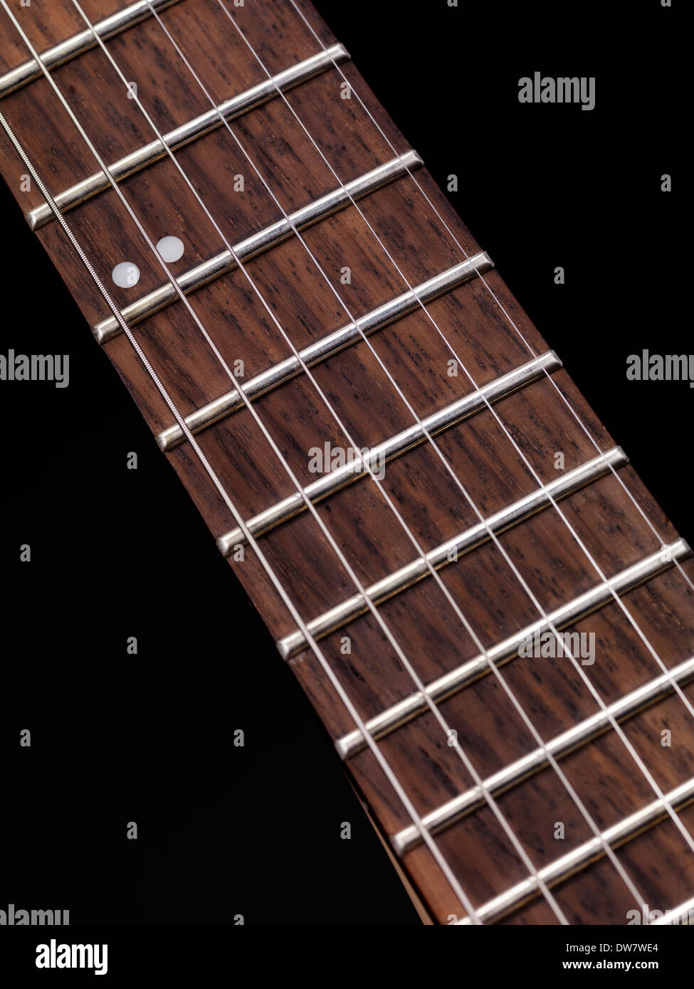 Closeup Of Electric Guitar Neck Fretboard And Strings