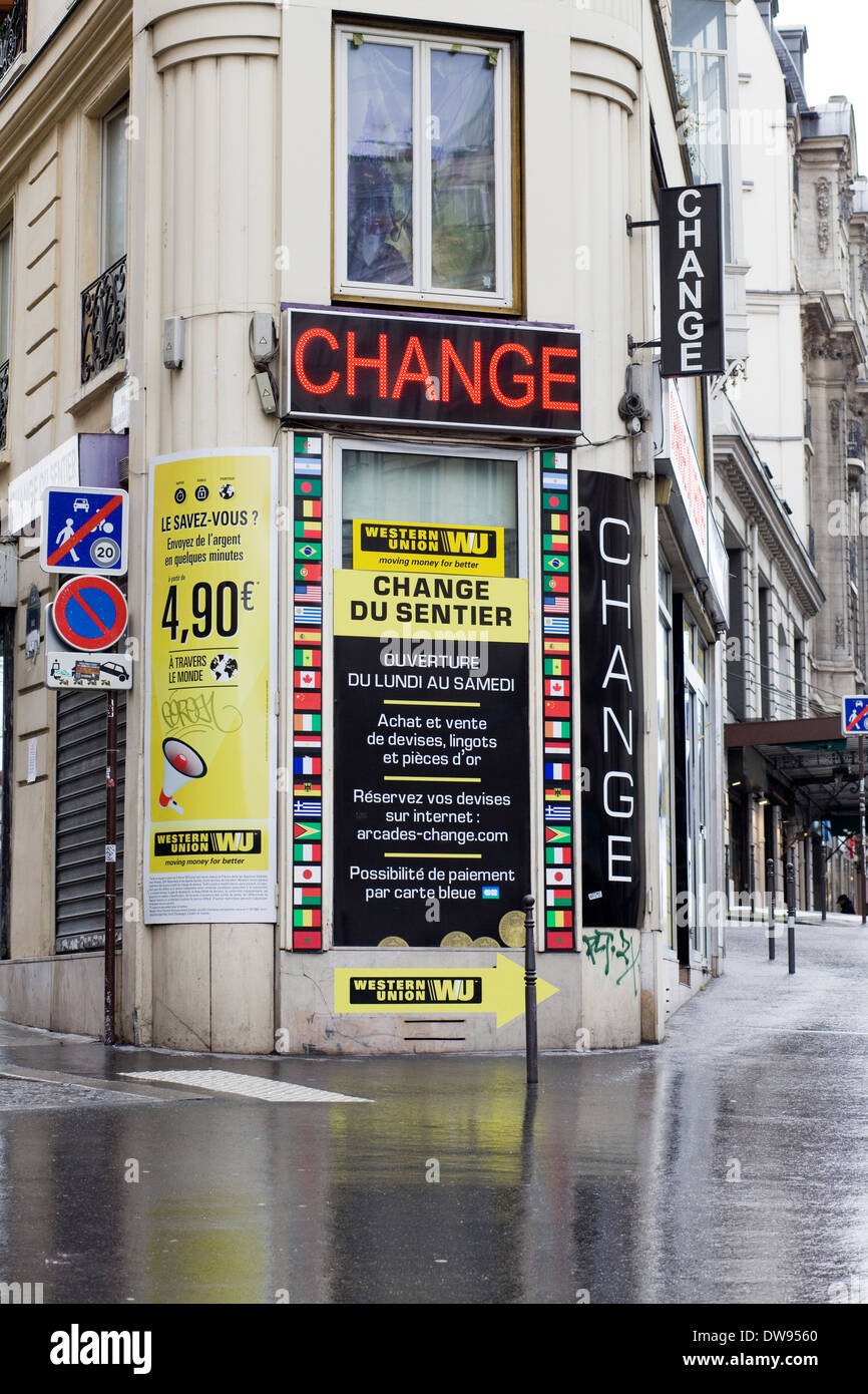 Bureau De Change Exchange Currency On The Streets Of Paris France In The Rain