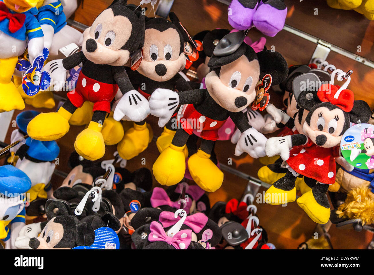 Mickey mouse and minnie dolls on racks for sale in disney outlet stock photo royalty free image - Disney store mickey mouse ...
