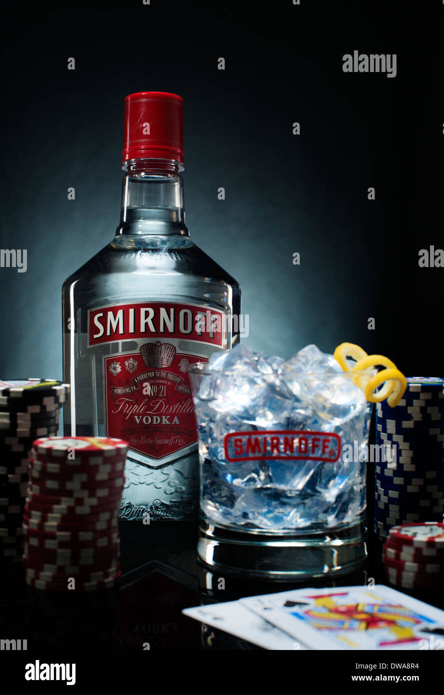 Smirnoff vodka bottle and glass on a table with poker chips and stock photo royalty free image - Picture of smirnoff vodka bottle ...