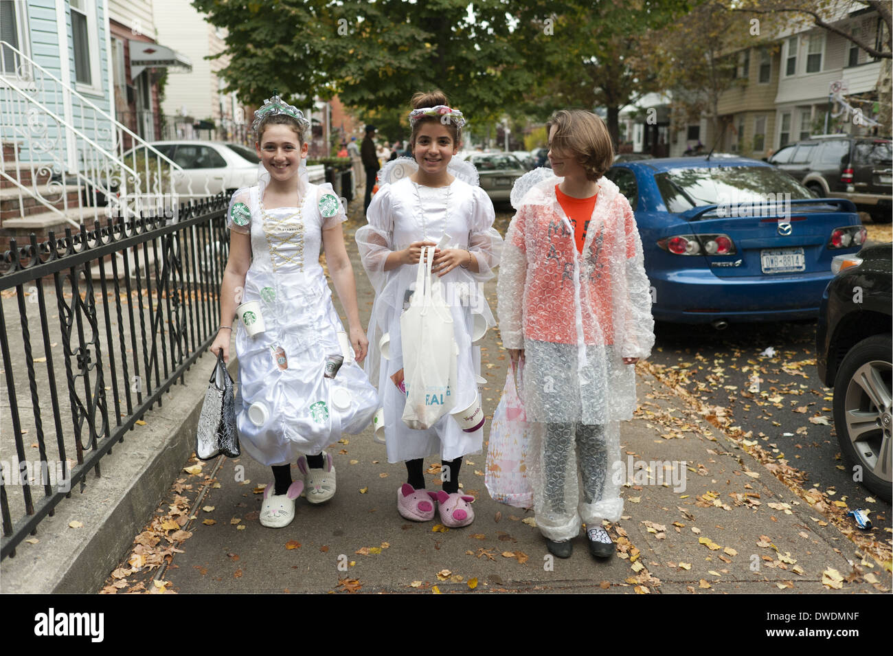 Halloween trick or treaters in the Kensington section of Brooklyn, NY.  Girls dressed in costumes made from recycled materials.