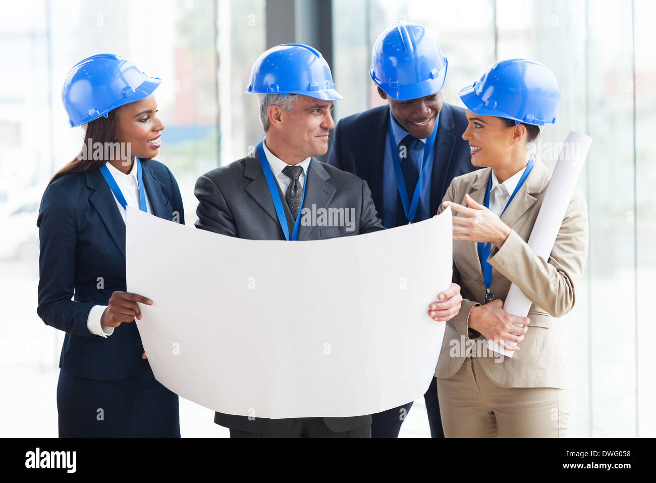 Stock Photo - team of successful architects interacting in office