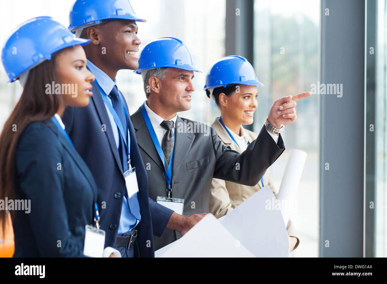 Stock Photo - group of successful architects discussing project in modern  office
