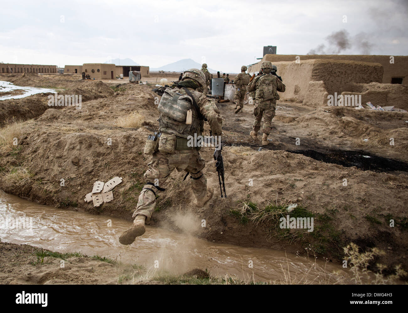 A US soldier during a reconnaissance patrol in a village during ...
