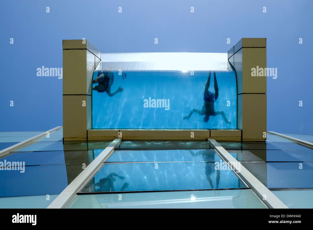 Elevated Pool tourist guests swimming in elevated glass swimming pool at stock
