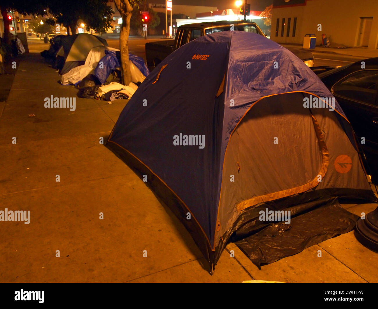 Tents and shelters of homeless people set up on the street in San Diego California USA & Tents and shelters of homeless people set up on the street in San ...