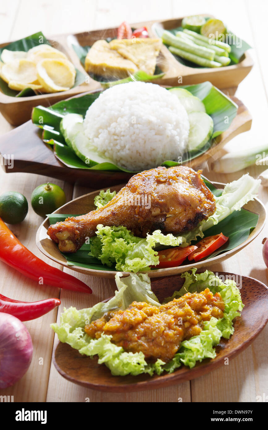 Famous traditional malay food delicious nasi ayam penyet for Authentic malaysian cuisine