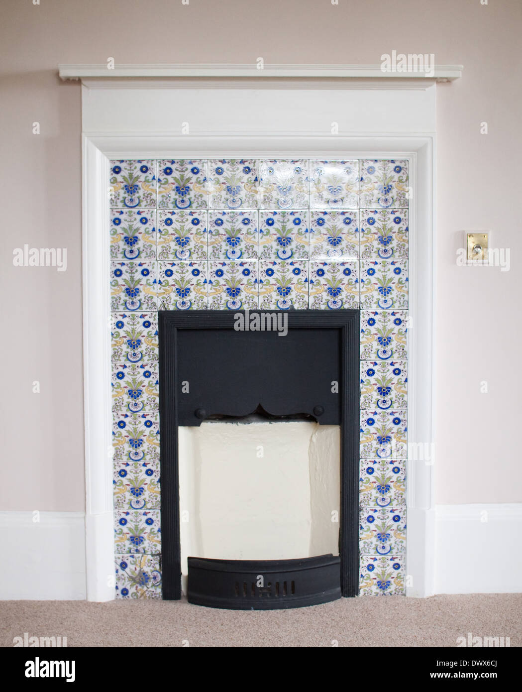delftware tiles round a fireplace in an english manor house in