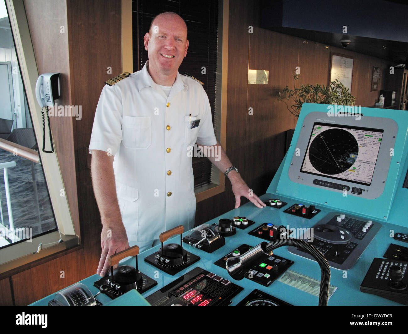 Cruise Ship Captain On Bridge With Controls Stock Photo Royalty - How to be a cruise ship captain