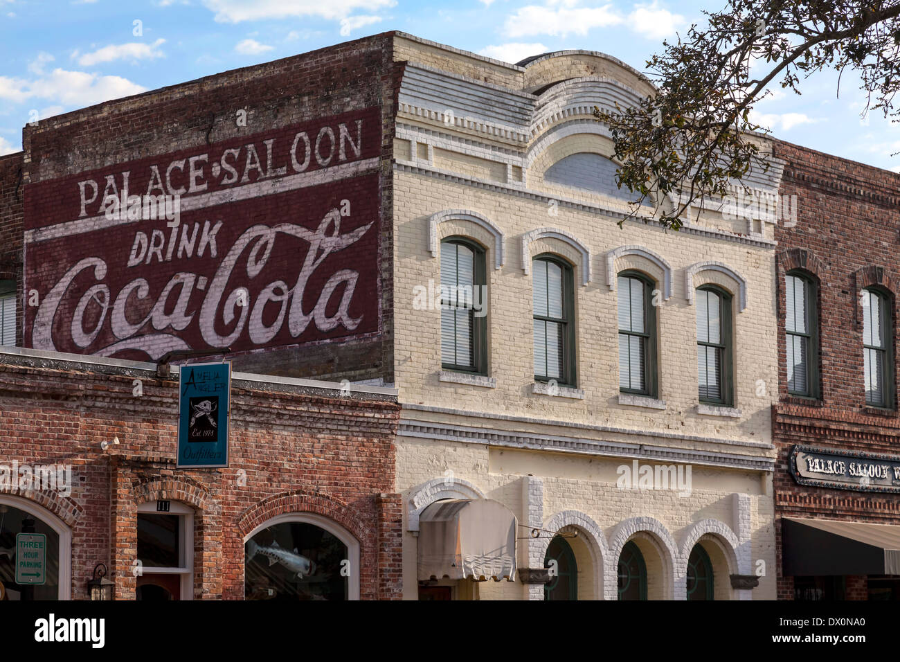 Handpainted Coca Cola sign on exterior brick wall of old building