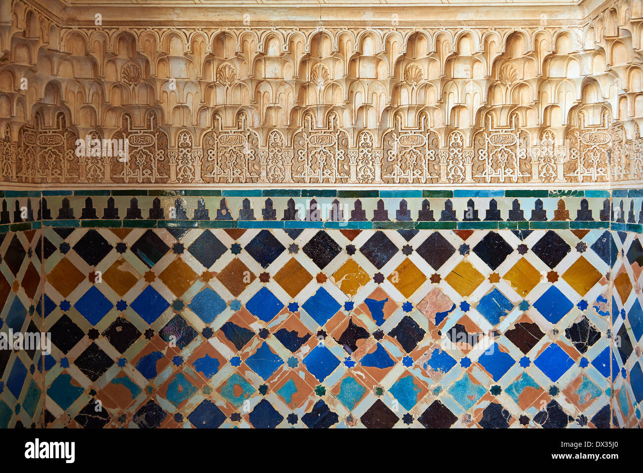 Muslim ceramic tiles stock photos muslim ceramic tiles stock moorish arabesque ceramic tiles sculpted plasterwork of the palacios nazaries alhambra granada andalusia dailygadgetfo Images