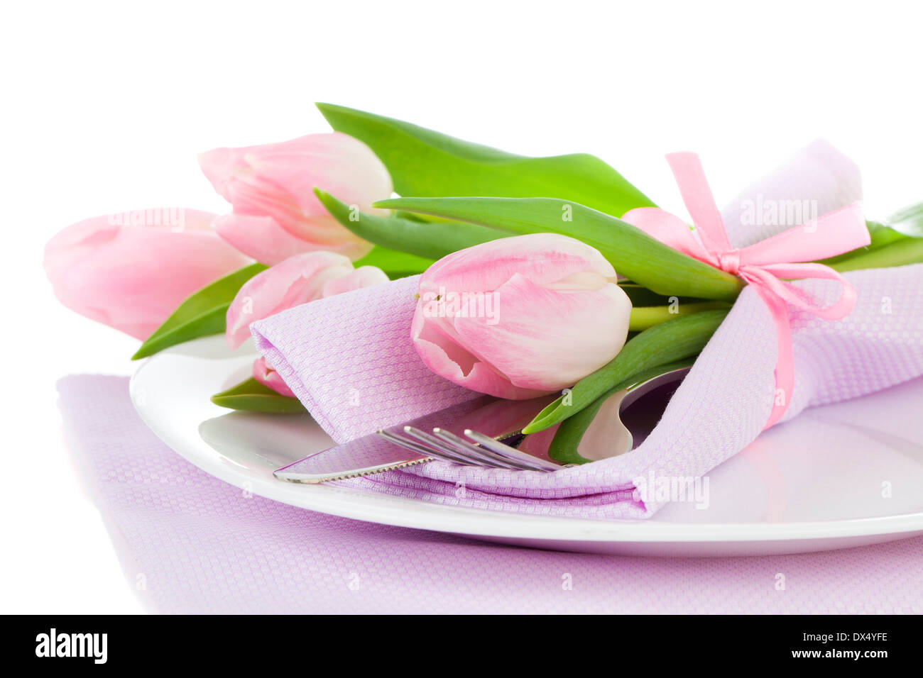 Table Setting Background romantic dinner / table setting with roses tulips and cutlery, on
