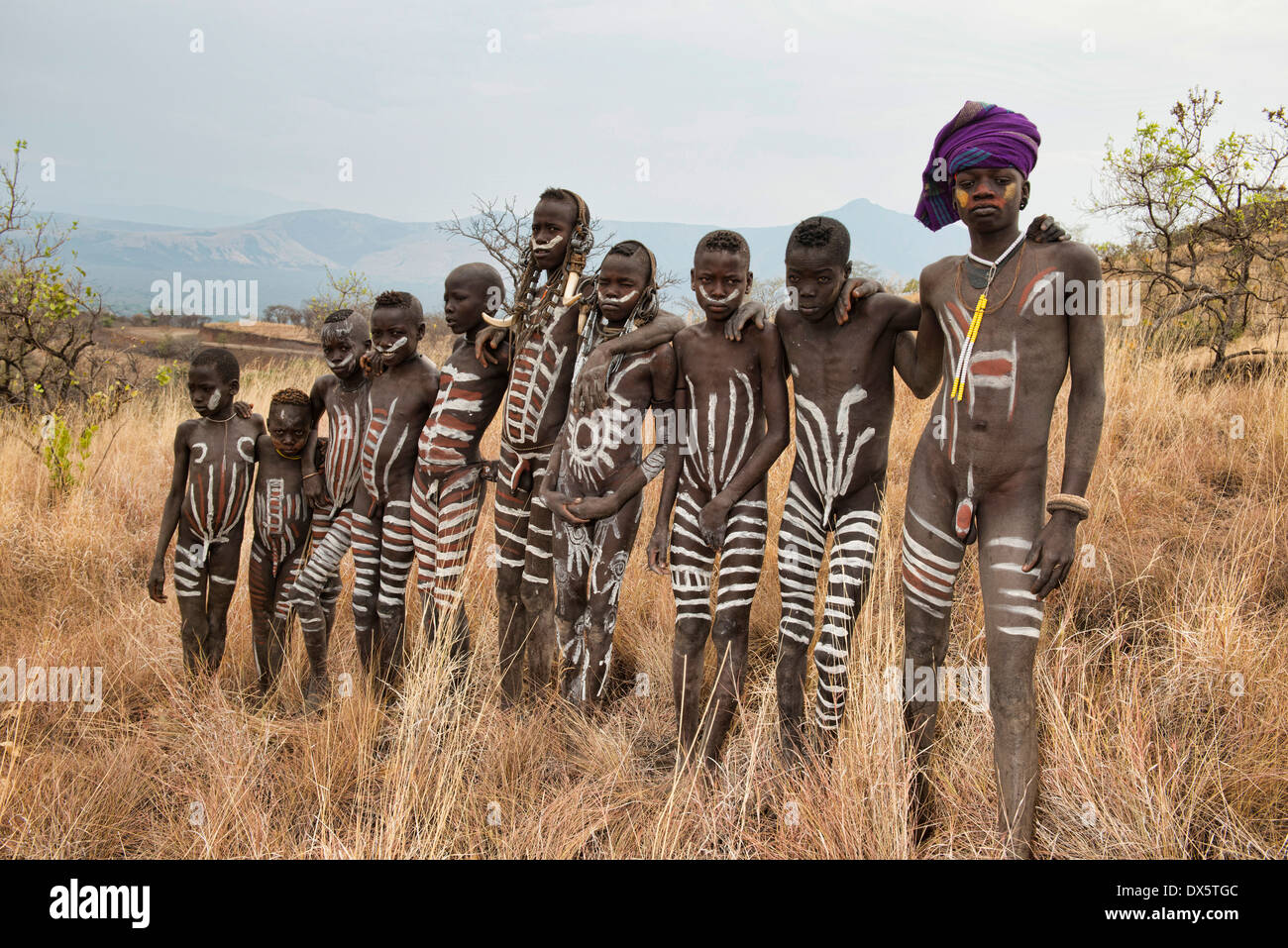 mursi Boy ... painted Mursi boys in Mago National Park, Lower Omo Valley of Ethiopia  - Stock Photo