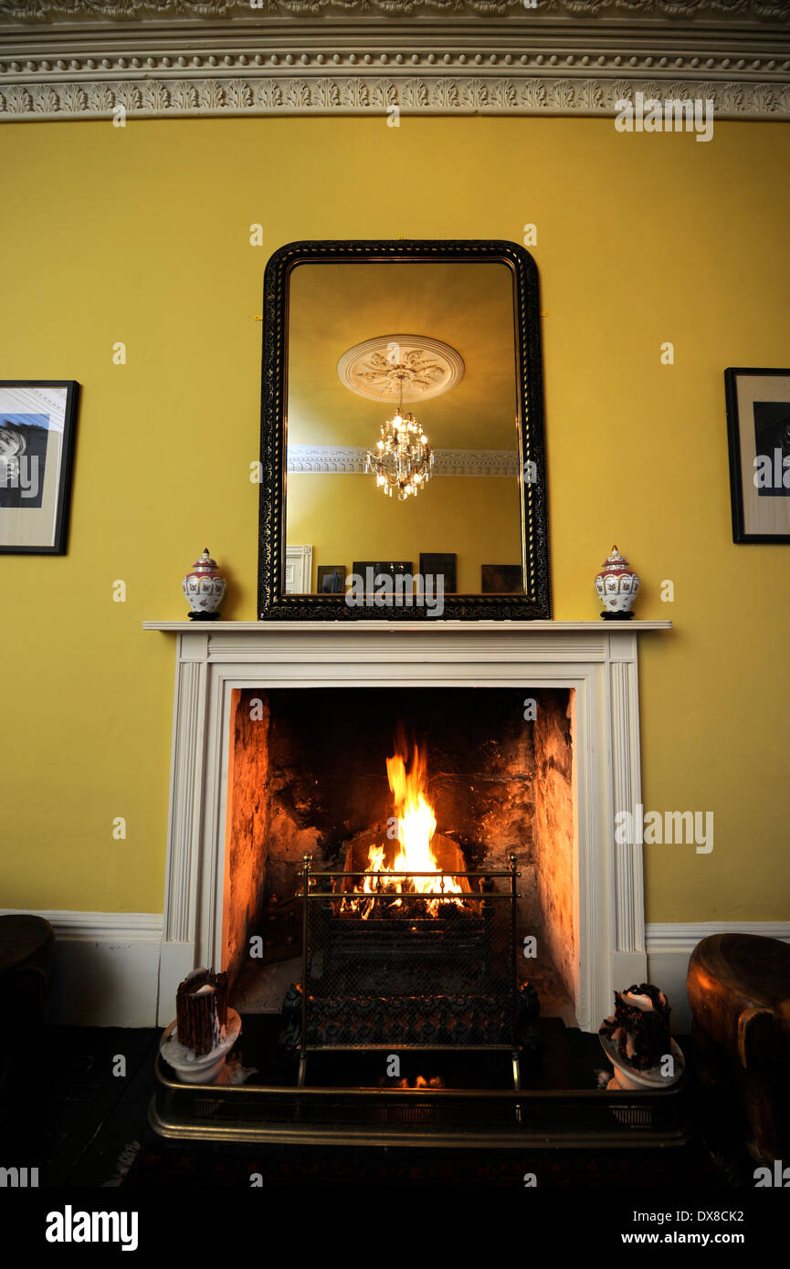 a traditional living room with an open fire in a georgian