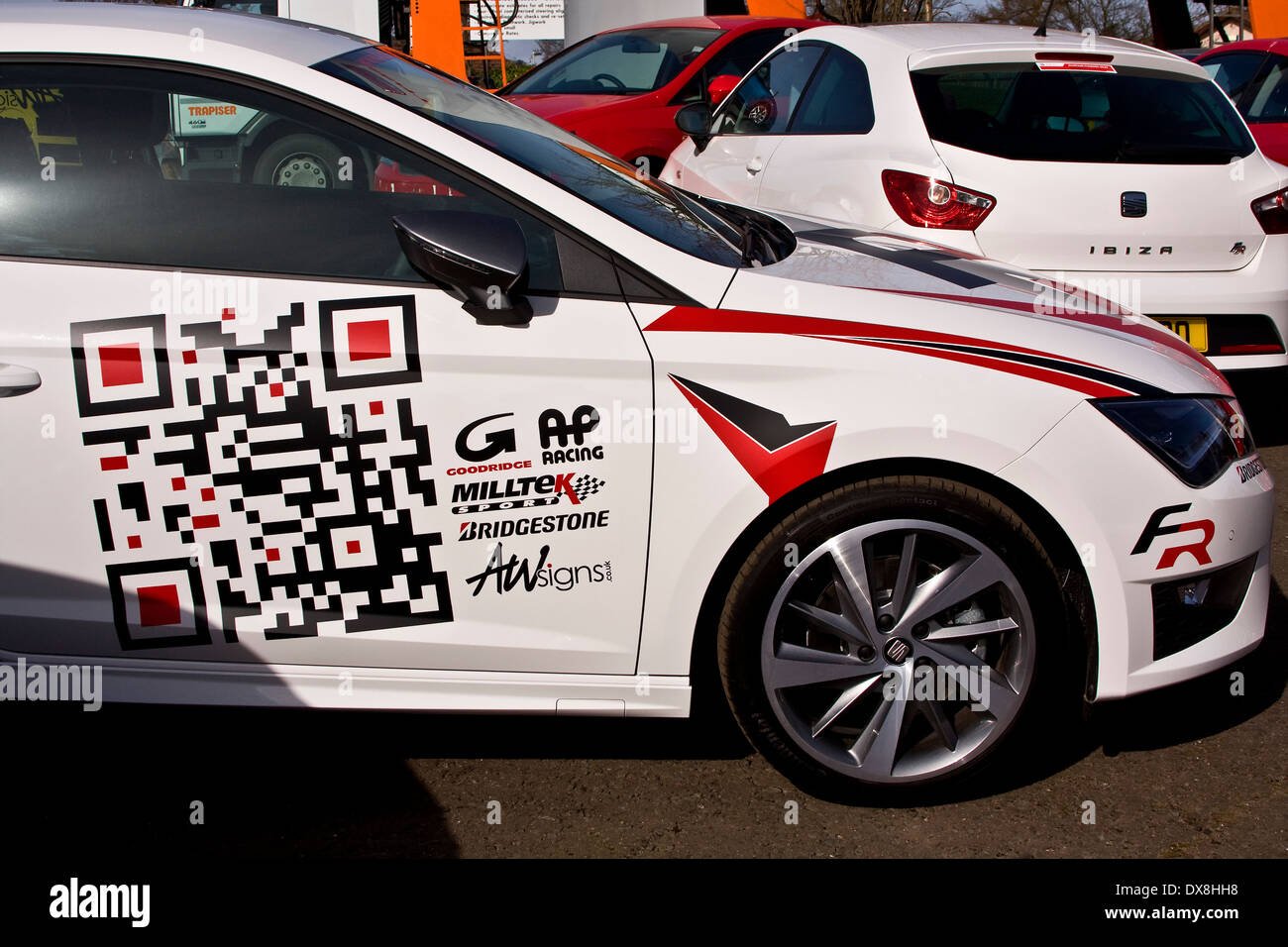Sport car sticker design - Stock Photo The New Seat Leon Sports Car With I Phone Application Stickers On The Door At The Alistair Fleming Car Showroom In Dundee Uk