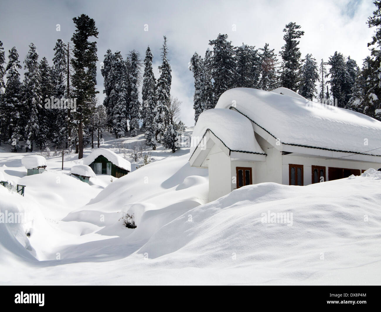 India kashmir gulmarg himalayan ski resort houses almost buried in heavy snowfall