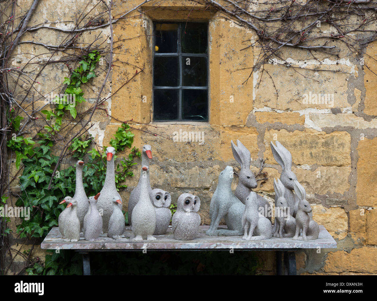 Outside ornaments - Stock Photo Stone Animal Ornaments On A Shelf Outside A Cotswold Stone House Broadway Cotwolds England