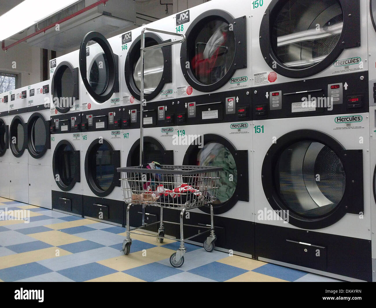 Fold laundry stock photos fold laundry stock images alamy an empty laundry room in an apartment building in new york on march 16 2014 solutioingenieria
