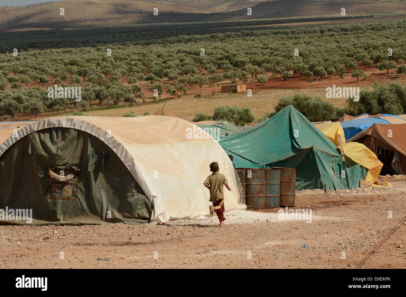 Small Child Runs Past Tents in Atmeh Refugee C& Inside Syria & Small Child Runs Past Tents in Atmeh Refugee Camp Inside Syria ...