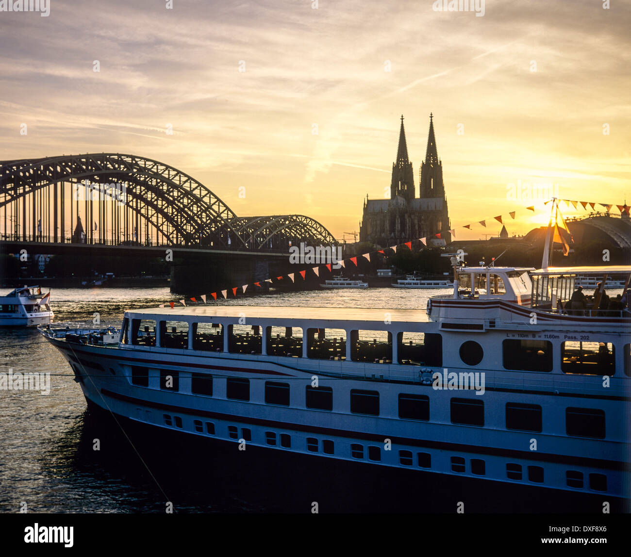 Cologne Cathedral At Dusk Evening Cityscape Wallpaper: Cruise Boat And Hohenzollern Bridge And Cathedral At