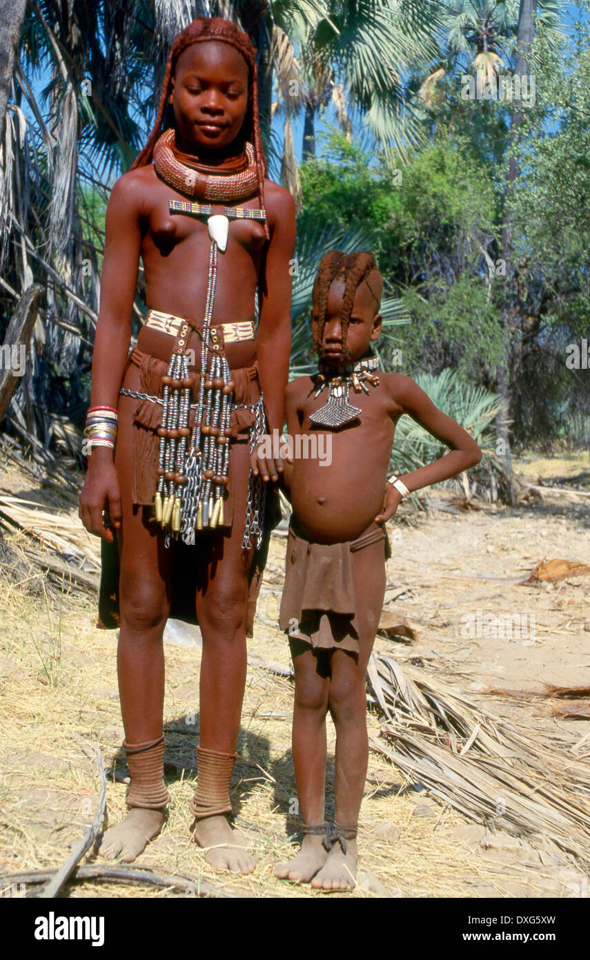 Himba girl and boy in the kaokoveld near the cunene river namibia