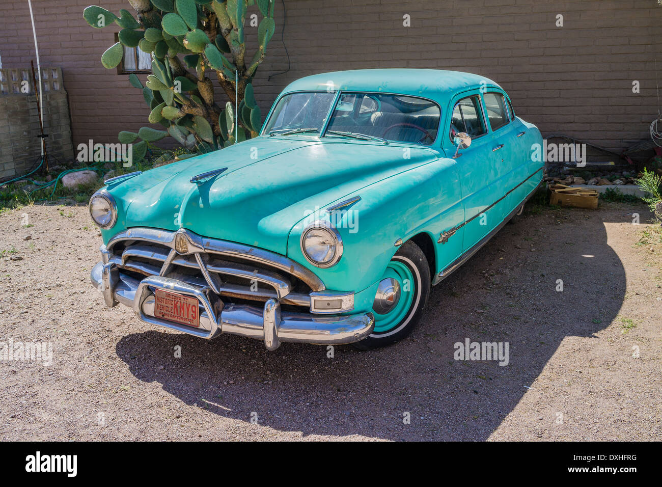 first generation 1951 1954 hudson hornet four door sedan in turquoise color with