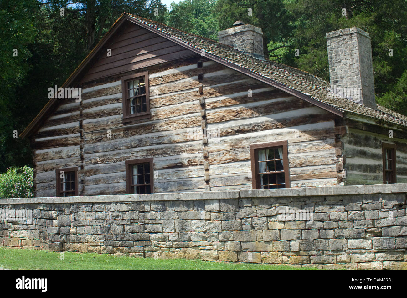 Log Home And Stone Wall Restored In Spring Mill Pioneer